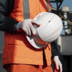 close up hand holding safety helmet 300x300