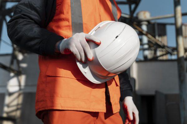 close up hand holding safety helmet 600x400