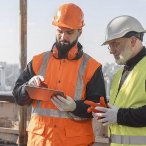 medium shot men looking at tablet 300x300